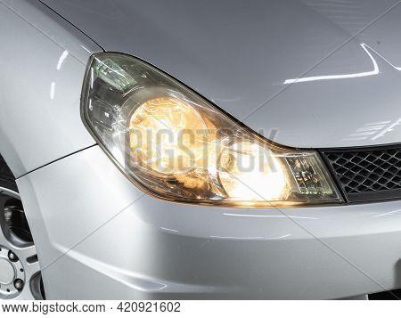 Novosibirsk, Russia - May 16, 2021: Nissan Wingroad,  Headlight Of A Modern Popular Car Close-up. Sh