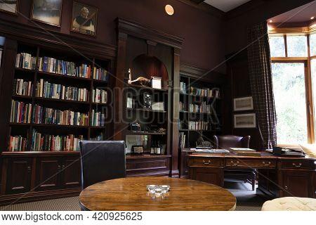 Rotorua New Zealand - May 8 2021; Bookshelves And Furniture Inside Traditional Room