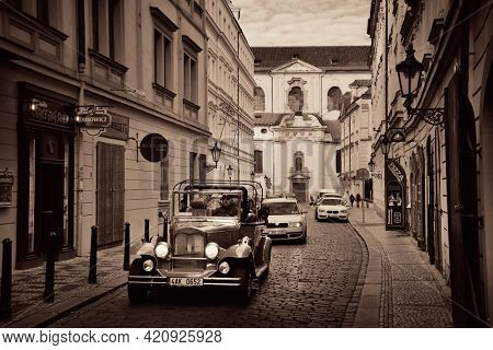 PRAGUE – OCT 8: Street view with vintage car on October 8, 2016 in Prague, Czech Republic. Prague is the capital and largest city in Czech Republic with rich culture and history.