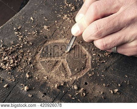 The Peace Symbol Carved In Wood With Chisels. Peace Concept, Global Solidarity, Woodworking