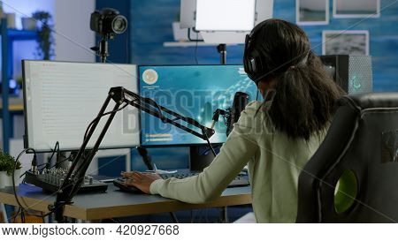 Black Player Wearing Headphones Talking With Other Players Chatting While Playing Professional Shoot