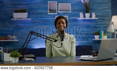 Portrait Of African Vlogger Working In Cozy Studio, Smiling At Camera Ready To Start New Podcast Sho