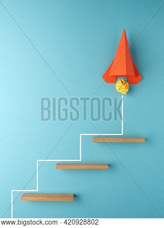 Orange Rocket Or Starship Climbing The Stairs On A Blue Background, Success Or Creativity Concept, S