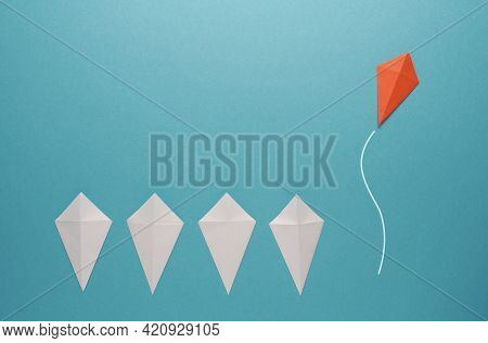 White Paper Kites In A Row With A Red Paper Kite Flying Away, Leadership Concept, Be Unique, Creativ