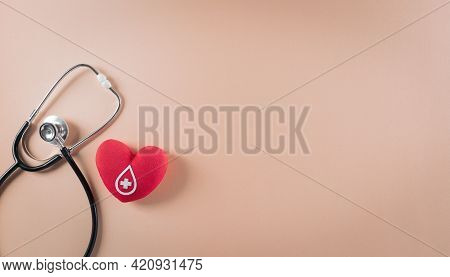Medical And Donor Concepts. Doctor Stethoscope And A Handmade Red Heart With A Sign Or Symbol Of Blo
