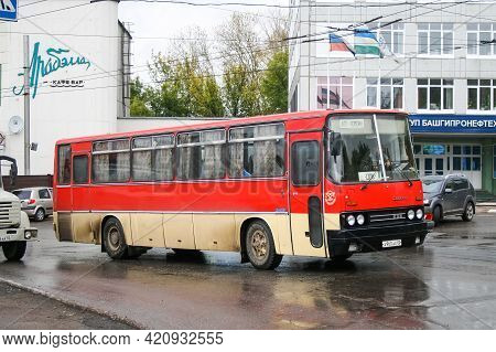 Ufa, Russia - September 26, 2008: Red Interurban Coach Bus Ikarus 256 In The City Street.