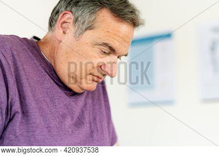 Mature man struggling at the gym