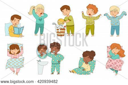 Cute Little Children Getting Ready To Bedtime Brushing Teeth, Reading Book And Sleeping In Their Bed