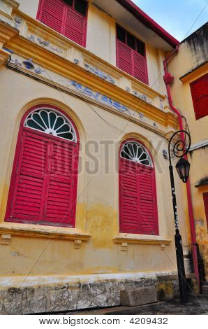 Historic Building With Red Louvered Windows