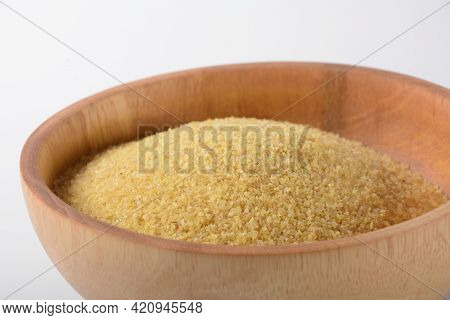 Uncooked Bulgur In Wooden Bowl On White Table Background, Rustic Style. Bulgur Wheat Grains