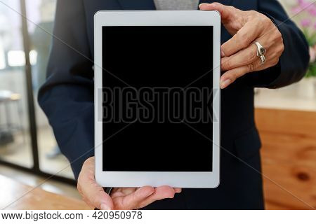 Man Holding Digital Tablet In Hand. Business Man Showing Digital Tablet With Blank Screen.