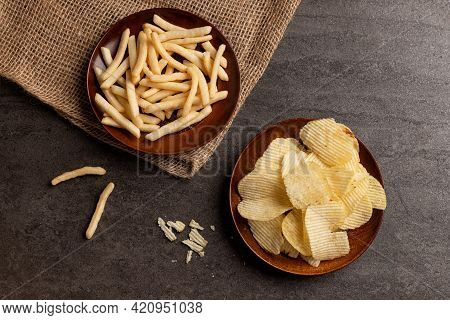 Top View Of Potato Chips And French Fries Snack In Dish.