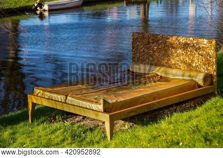 22 January 2021, Leiden, Netherlands, Golden Bed As A Exhibit In Front Of The National Museum Of Eth