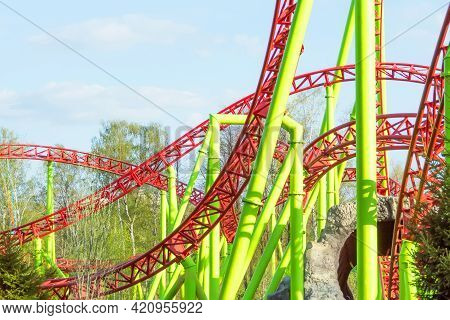 Loop And Turn On A Roller Coaster In An Amusement Park.