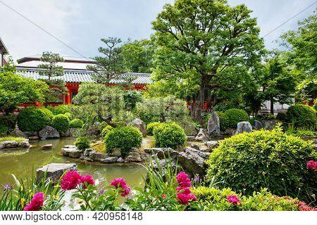 Japanese Garden In Fushimi Inari Taisha Shrine In Kyoto, Japan With Beautiful Red Gates. Blossoming