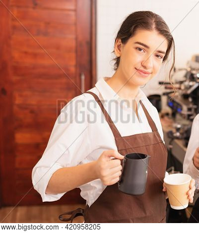 Half-body Right Side Angle Of Beautiful Caucasian Barista Women Fills White Milk Into Takeaway Hot C