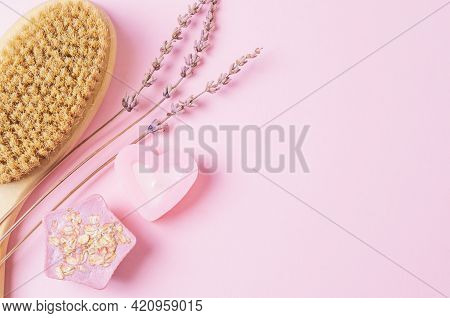 Body Care Products On A Pink Background. Handmade Soap, Candle, Wooden Brush For Body Dry Massage.sk