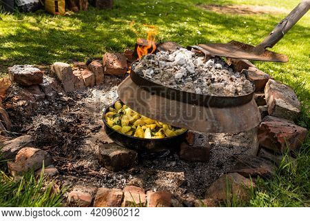 Cooking Traditional Dalmatian, Croatian, Bosnian Dish Called Peka. Meat, Potatoes And Vegetables In