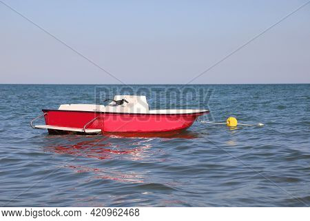 Red Motorboat In The Middle Of The Sea To Rescue Swimmers