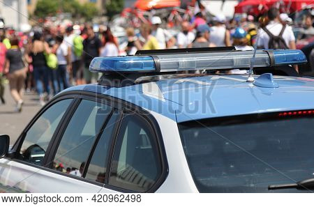 Police Car With Sirens In The Crowd During An Unauthorized Demonstration
