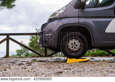 Camper Leveling Yellow Block In Use. Leveler Ramp Chock Blocks For Rv Travel Trailer. Accessories Fo