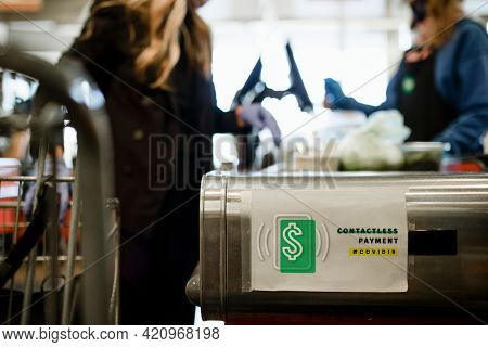 Contactless payment on a paper mockup during coronavirus pandemic