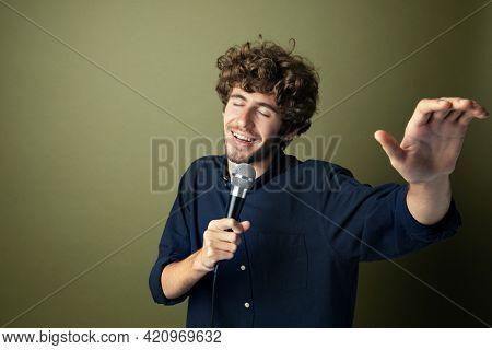 Man singing and enjoying karaoke