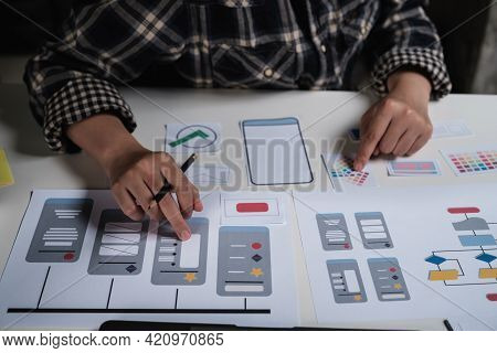 Closeup Of Male Ux Developer And Ui Designer About Mobile Phone App Interface In Living Room At Home