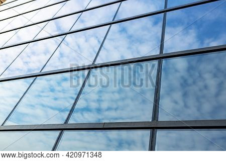 Glass Skyscraper Against Blue Sky, View From Bottom