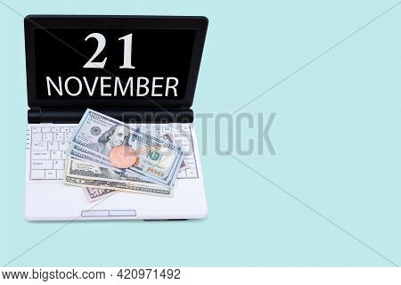 21st Day Of November. Laptop With The Date Of 21 November And Cryptocurrency Bitcoin, Dollars On A B