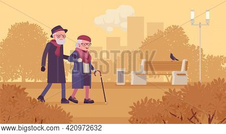 Active Seniors, Happy Healthy Elderly People Walking Through The Autumn Park. Couple Of Older Adults