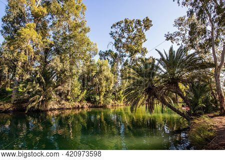 Israel. The fine winter sunny day. Wonderful walk along the river. The Jordan River is the most famous river in the world. Jordan is the place of the baptism of Christ.