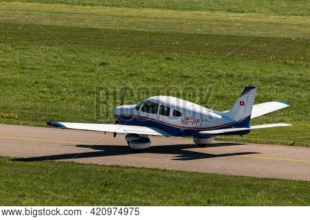 Piper Pa-28-181 Archer Aircraft Is Taxiing At The Airport Saint Gallen Altenrhein In Switzerland 23.