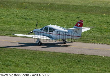 Rockwell Commander 114b Aircraft Is Taxiing At The Airport Saint Gallen Altenrhein In Switzerland 23