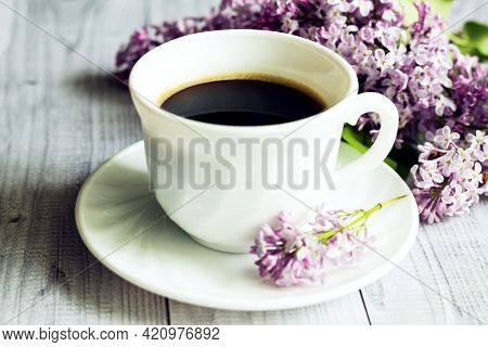 Morning Cup Of Coffee And Lilac Flowers