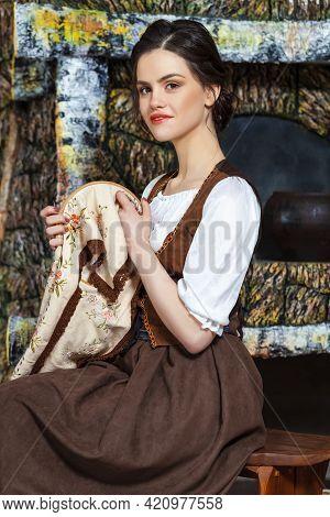 Lovely Caucasian Brunette Woman Posing With Fancywork Hoop In Retro Dress In Rural Environment. Vert