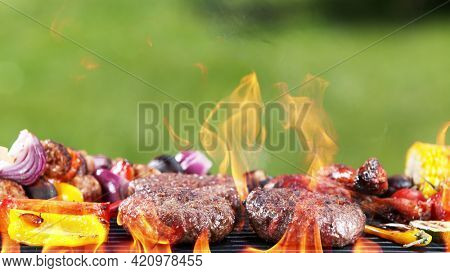 Assorted delicious grilled hamburger meat with vegetables. Outdoor grill barbecue mix.