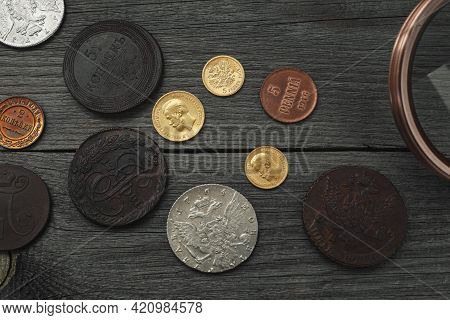 Numismatics. Old Collectible Coins Of Silver, Gold And Copper On The Table. Top View.