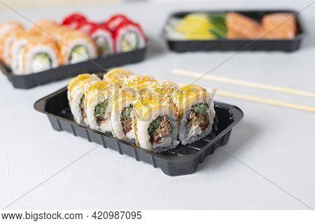 Lunch Boxes With Sushi Set. Assorted Fresh Rolls Philadelphia, California, Sashimi On Light Backgrou