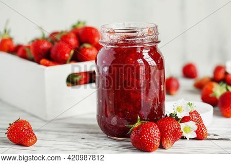 Homemade Strawberry Preserves Or Jam In A Mason Jar Surrounded By Fresh Organic Strawberries. Select