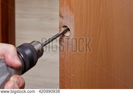 Drilling Hole For Latch In Wooden Interior Door With Using Flat Bit.