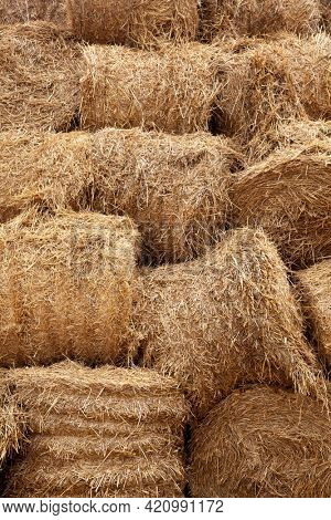 Stacked Straw Hay Bails Background. Agriculture farm and farming symbol
