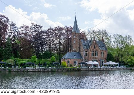 The Kasteel Minnewater Restaurant On The Canals Of Bruges In The Historic City Center