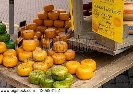 Close Up View Of A Selection Of Delicious Gouda Cheeses For Sale At The City Market