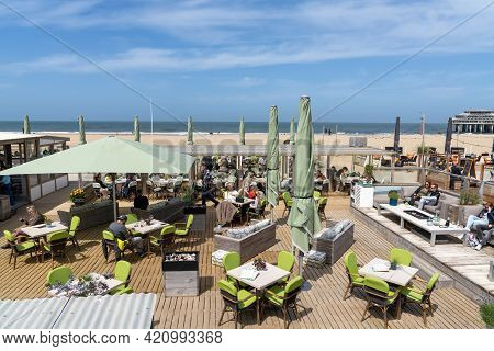 People Enjoying A Meal And A Drink In One Of The Restaurants On The Beach At The Seaside Resort Of S