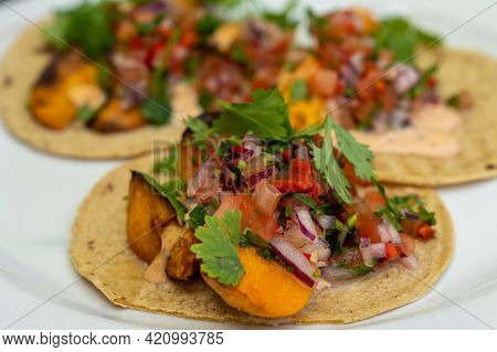 A Close Up View Delicious Vegan Tacos With Sweet Potatoes And Cilantro And Vegetables