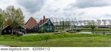 Idyllic Canals And Landscape With 19Th-century Dutch Farmhouses Under An Expressive Sky