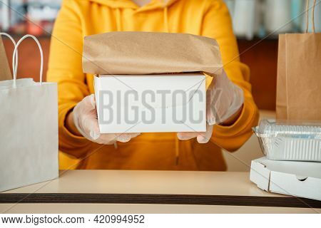 Waiter Giving Takeout Meal While City Covid 19 Lockdown, Coronavirus Shutdown. Baking To Go, Takeawa