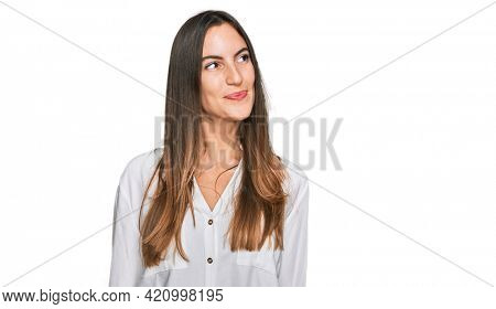Young beautiful woman wearing casual clothes smiling looking to the side and staring away thinking.