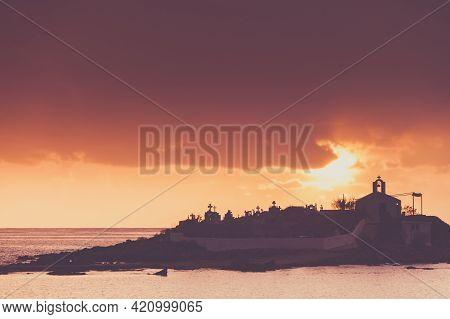 Agios Fokas Near Monemvasia In Stormy Weather Overcast Sky, Sunrise. Small Cemetery On Sea Shore, Ma